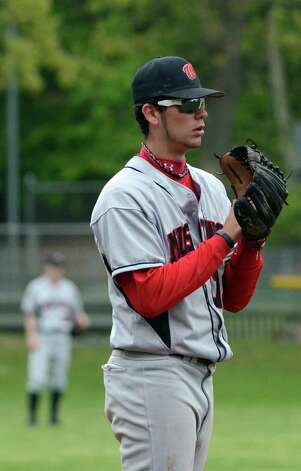 Fairfield Warde's Dario Pugliano (12) during the baseball game against New Canaan at Mead Park in New Canaan on Wednesday, May 2, 2012. Photo: Amy Mortensen / Connecticut Post Freelance