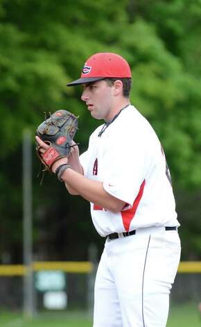 New Canaan's Michael Keshin (20) pitches during the baseball game against Fairfield Warde at Mead Park in New Canaan on Wednesday, May 2, 2012. Photo: Amy Mortensen / Connecticut Post Freelance