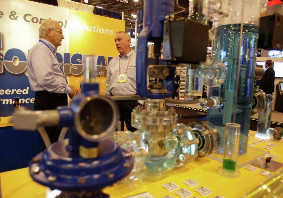 Ray Lingo, manufacturer's representative, left, and Gary Kendall, sales manager, both with Norriseal of Houston talk near their display of oil and gas separation equipment at OTC in Reliant Center  Wednesday, May 2, 2012. (Melissa Phillip / Chronicle) Photo: Melissa Phillip, Houston Chronicle / © 2012 Houston Chronicle