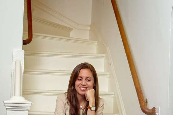 Ninive Calegari with her son Pablo Calegari at her home in San Francisco Calif., is seen on Wednesday, March 7th, 2012. She is a co-founder of 826 Valencia Street and the President of the Teacher Salary Project