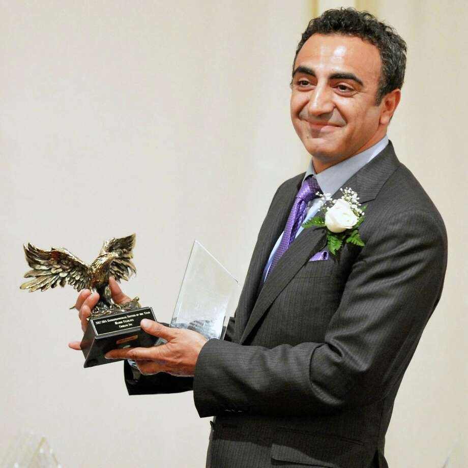 Hamdi Ulukaya, founder and CEO of the company that makes Chobani Greek yogurt receives a national award during a Small Business Administration luncheon in Colonie Wednesday May 2, 2012.  (John Carl D'Annibale / Times Union) Photo: John Carl D'Annibale / 00017524A