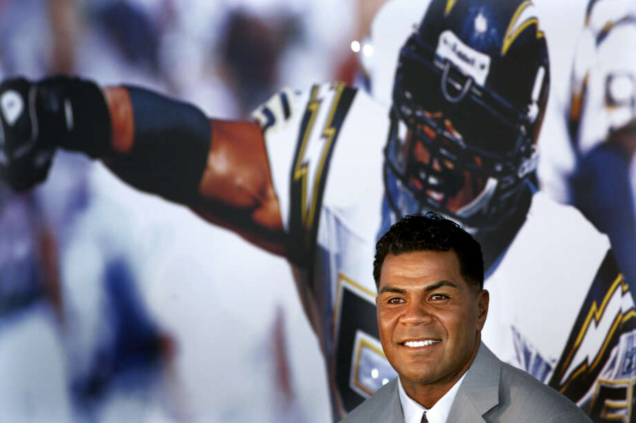 In this Aug. 14, 2006, file photo, former San Diego Chargers football player Junior Seau smiles during a news conference announcing his retirement from pro football in San Diego. Police say Seau, a former NFL star, was found dead at his home in Oceanside, Calif., Wednesday, May 2, 2012, after responding to a shooting there. He was 43. (AP Photo/Sandy Huffaker, File) Photo: Sandy Huffaker, Associated Press / 2006 AP