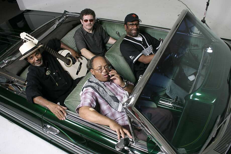 Four members of the 70s rock band War have formed a new band, Lowrider Band. Front seat:  driver: HOWARD SCOTT uitar/vocals) passenger:  B.B. DICKERSON  (bass/vocals) Back seat:  behind the driver - LEE OSKAR (harmonica)   Next to him is - HAROLD BROWN (drums/vocals) Photo: Carlos Aceves
