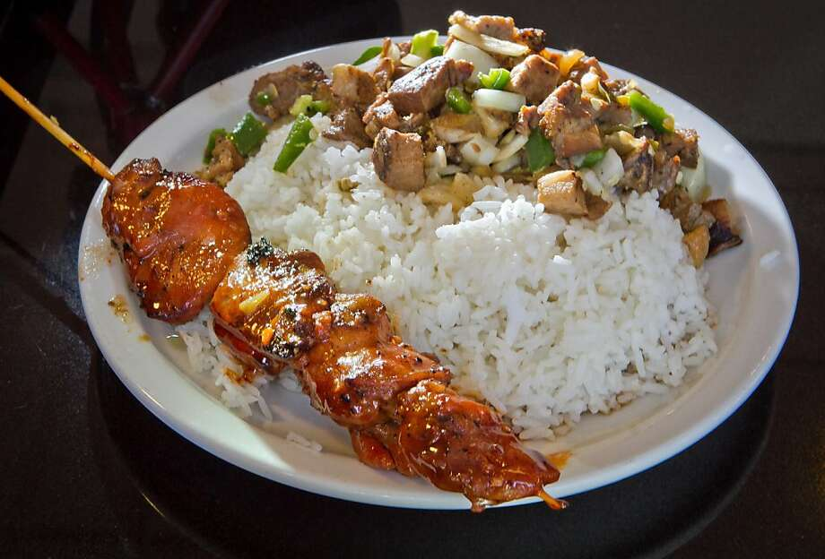 BBQ Chicken and Sisig Pork with rice at Irma's Pampanga Restaurant in San Francisco, Calif., is seen on April 27th, 2012. Photo: John Storey, Special To The Chronicle