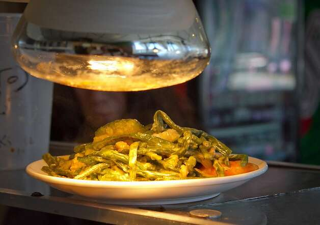 Kari Kari Oztail under a heat lamp at Irma's Pampanga Restaurant in San Francisco, Calif., is seen on April 27th, 2012. Photo: John Storey, Special To The Chronicle