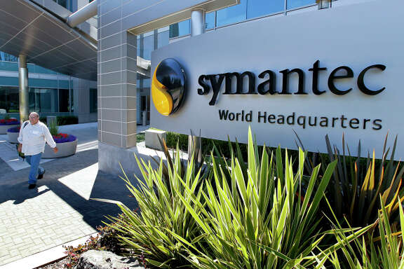 A visitor exits the headquarters building of Symantec Corp. in Mountain View, California, U.S., on Tuesday, Aug. 24, 2010. Intel Corp.' $7.68 billion purchase of McAfee Inc. may put pressure on rival Symantec Corp., the largest supplier of security software, to build hacker-thwarting technology inside corporate computers and forge new alliances to stay competitive. Sales will reach $16.5 billion this year in the global security software market according to Gartner Inc. Photographer: Tony Avelar/Bloomberg