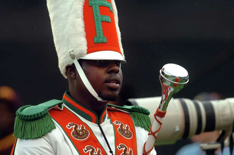 FILE - In this Saturday, Nov. 19, 2011 file photo, Robert Champion, a drum major in Florida A&M University's Marching 100 band, performs during halftime of a football game in Orlando, Fla. At least five people will face criminal charges in the hazing death Champion aboard a band bus in Orlando last fall, authorities said Tuesday, May 1, 2012. (AP Photo/The Tampa Tribune, Joseph Brown III, File) SST. PETERSBURG OUT; LAKELAND OUT; BRADENTON OUT; MAGS OUT; LOCAL TV OUT; WTSP CH 10 OUT; WFTS CH 28 OUT; WTVT CH 13 OUT; BAYNEWS 9 OUT Photo: Joseph Brown III / AP2011