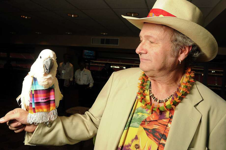 Bob Bednar and Peachy Boy at the Cinco de Mayo-themed reception held by Siemens at the West Club in Reliant Stadium Wednesday, May 2, 2012. (Dave Rossman Photo) Photo: Dave Rossman, For The Chronicle / © 2012 Dave Rossman