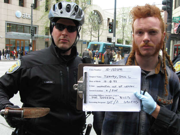 Protester Jack Tierney, right, is pictured in a Seattle Police Department photo. Also pictured is the fixed-blade knife Seattle prosecutors contend Tierney was carrying during Tuesday's protests. Photo: Lindsey Wasson/Seattlepi