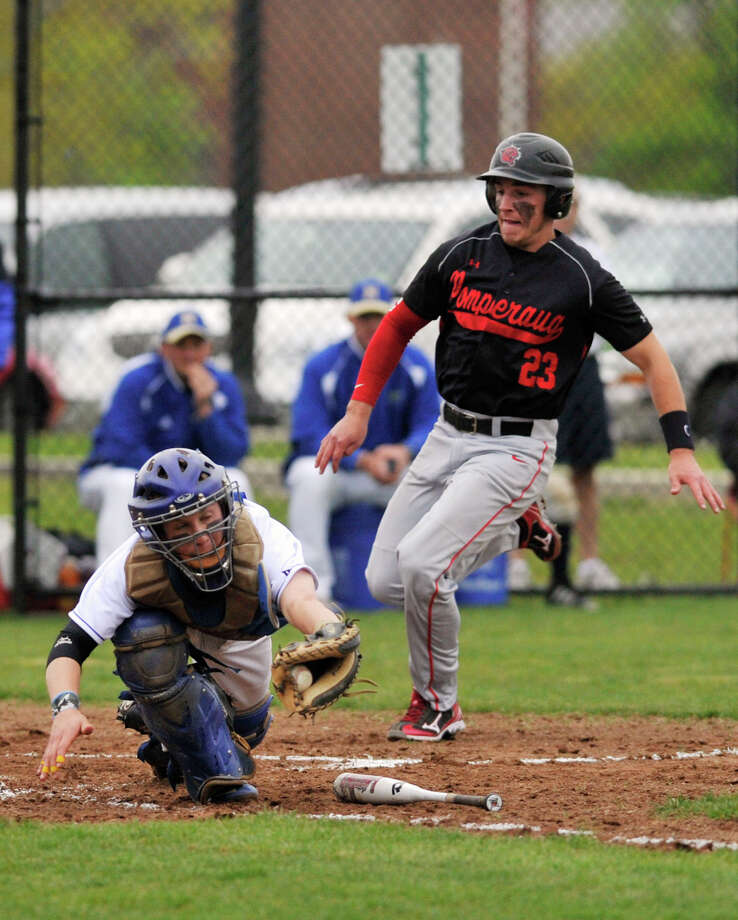Pomperaug's Nick DeLotto comes home safe as Newtown catcher Mike Allwein fields the ball during their game at Fairfield Hills Campus in Newtown on Wednesday, May 2, 2012. Pomperaug won 7-4. Photo: Jason Rearick / The News-Times