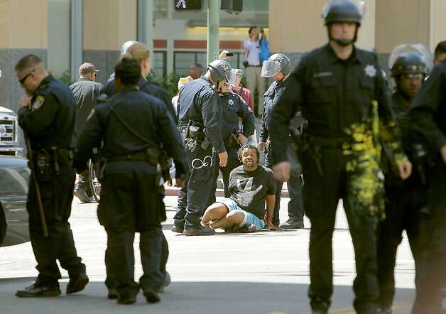 Oakland Police arrest an occupy protester on 14th St. and Clay St. behind City Hall, in downtown Oakland Ca., on Tuesday May 1, 2012, during the May Day general strike. Photo: Michael Macor, The Chronicle