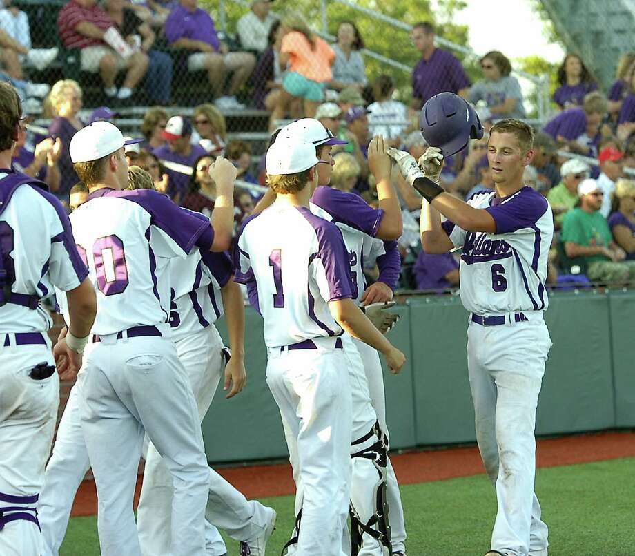 Indian #6, Colton Ward, right, takes high fives after scoring a run. The Port Neches-Groves baseball team played Baytown Lee Wednesday night, May 2, 2012, at Vincent Beck Stadium on the Lamar University campus.  Dave Ryan/The Enterprise Photo: Dave Ryan