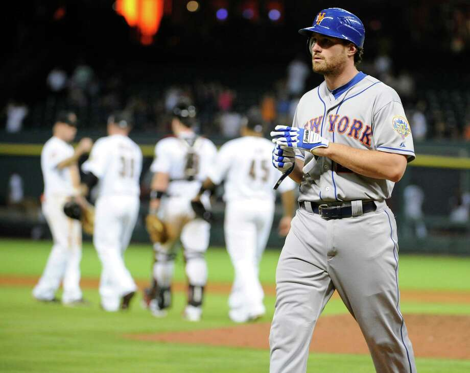 New York Mets' Daniel Murphy leaves the field after flying out to left field to end the baseball game against the Houston Astros on Tuesday, May 1, 2012, in Houston. The Astros won 6-3. (AP Photo/Pat Sullivan) Photo: Pat Sullivan
