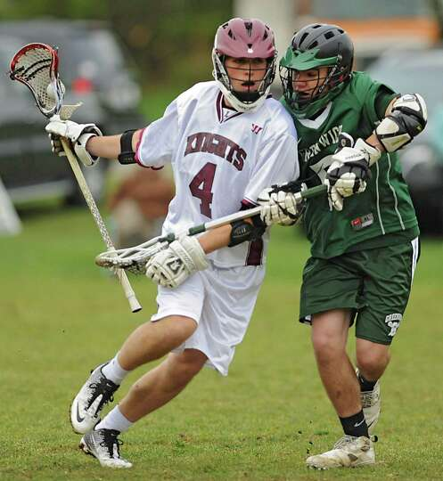 Lansingburgh's Colin Winters ,#4, is defended by Greenwich's Weldon Graziano during a lacrosse game