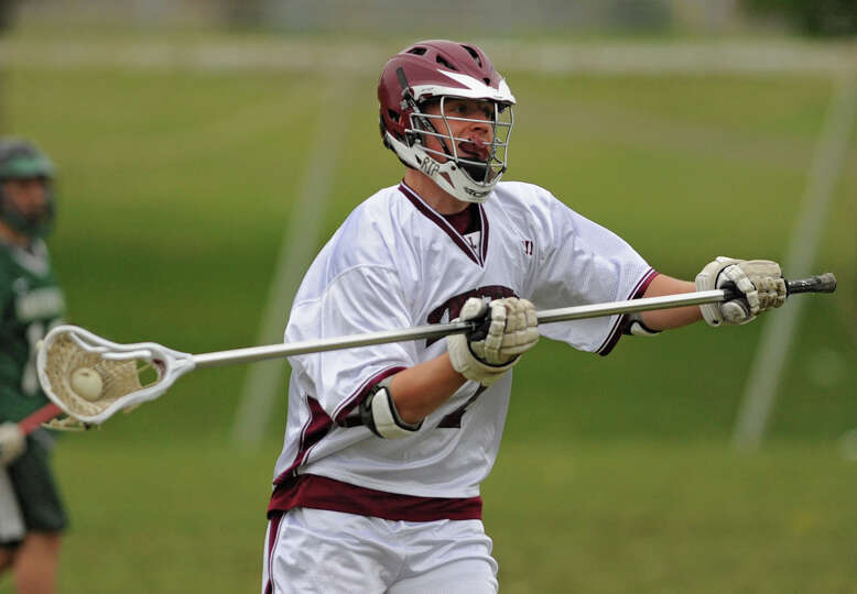 Lansingburgh's Corey Robinson passes the ball during a lacrosse game against Greenwich Wednesday, Ma