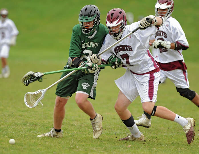 Greenwich's Tanner Copeland and Lansingburgh's Corey Robinson battle for the ball during a lacrosse