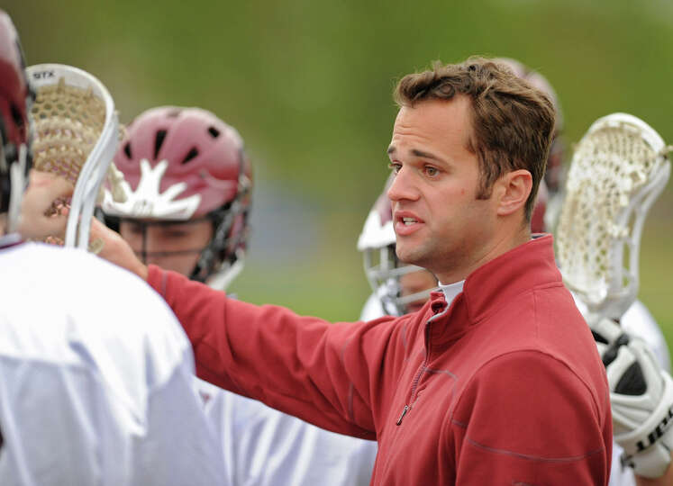 Lansingburgh head coach Shane Hendry talks to his players during a lacrosse game against Greenwich W