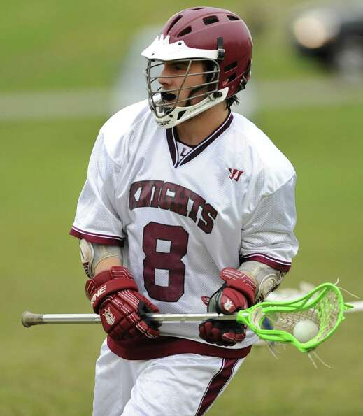 Lansingburgh's Joe Chenaille runs with the ball during a lacrosse game against Greenwich Wednesday,
