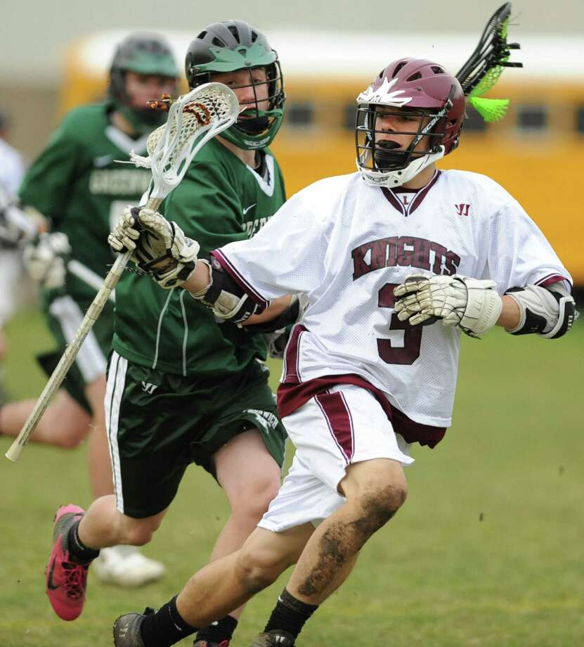 Lansingburgh's Shay Curtis, right, is defended by Greenwich's Dave Almy during a lacrosse game Wednesday, May 2, 2012 in Troy, N.Y. (Lori Van Buren / Times Union) Photo: Lori Van Buren