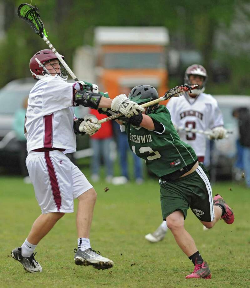 Lansingburgh's Colin Winters takes a shot at the goal as Greenwich's Dave Almy tries to stop him during a lacrosse game Wednesday, May 2, 2012 in Troy, N.Y. (Lori Van Buren / Times Union) Photo: Lori Van Buren