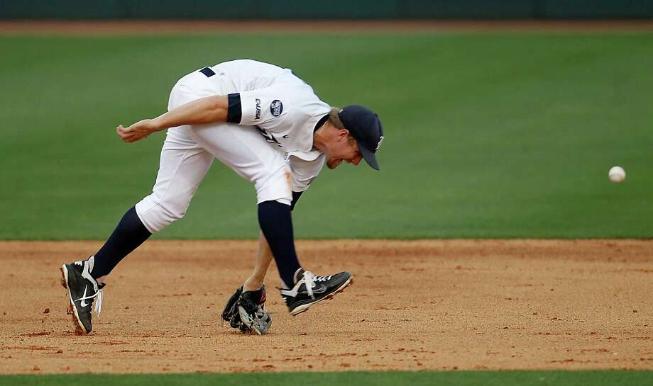 Rice's third baseman Shane Hoelscher (2) chases a ball hit by TSU's Corbin Smith (21) in the 5th inning at Rice University during a college baseball game at Reckling Park, Wednesday, May 2, 2012, in Houston. Photo: Karen Warren, Houston Chronicle / © 2012  Houston Chronicle
