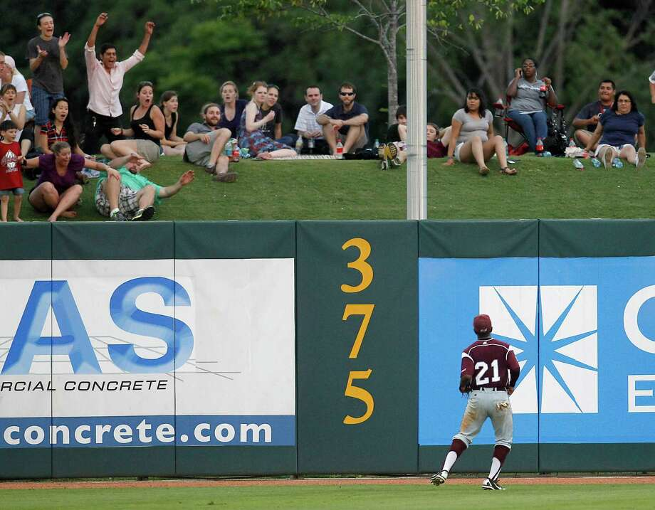 TSU's LF Corbin Smith watches Michael Ratterree's home run ball go over the fence in the 5th inning, which was also Rice's first hit of the night at Rice University during a college baseball game at Reckling Park, Wednesday, May 2, 2012, in Houston. Photo: Karen Warren, Houston Chronicle / © 2012  Houston Chronicle