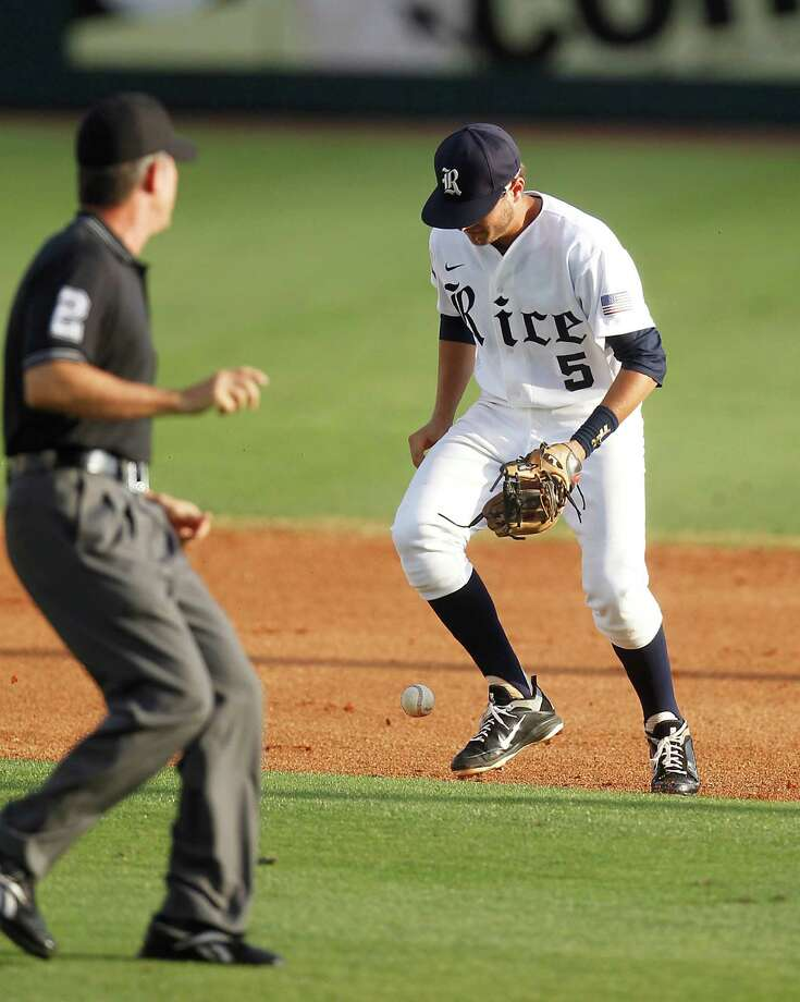 Rice's second baseman Christian Stringer (5) is called for an error on a ball hit by TSU's Cameron Logan (27) in the first inning at Rice University during a college baseball game at Reckling Park, Wednesday, May 2, 2012, in Houston. Photo: Karen Warren, Houston Chronicle / © 2012  Houston Chronicle