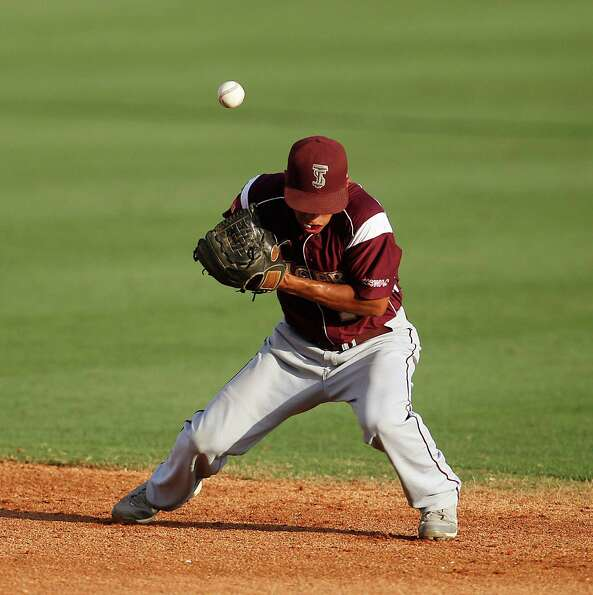 TSU's second baseman Chris Deleon (10) bobbles the ball for the error hit by Rice's Christian String