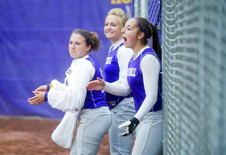 Westhill's Allie Souza, Allison Macari and Cassandra Kish come out of the pen to cheer for Megan D'Alessandro as she rounds the basis after hitting a homer as Westhill High School hosts Danbury in a softball game in Stamford, Conn., Sunday, May 2, 2012. Photo: Keelin Daly / Stamford Advocate