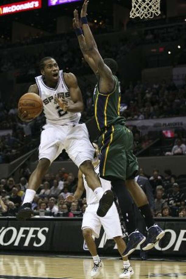 Spurs rookie Kawhi Leonard drives to the goal through the Jazz's Josh Howard during the first half of game two of the Western Conference first round at the AT&T Center, Sunday, May 2, 2012. Jerry Lara/San Antonio Express-News (Jerry Lara / San Antonio Express-News)
