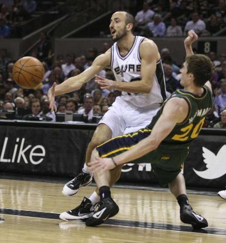 The Spurs'  Manu Ginobili passes the ball as the Jazz's Gordon Hayward tries to defend during the first half of game two of the Western Conference first round at the AT&T Center, Sunday, May 2, 2012. Jerry Lara/San Antonio Express-News (Jerry Lara / San Antonio Express-News)