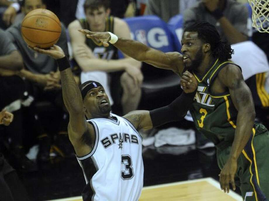The Spurs'  Stephen Jackson (left) shoots as the Jazz's DeMarre Carroll defends during NBA playoffs action at the AT&T Center on Wednesday, May 2, 2012.  Billy Calzada / San Antonio Express-News (BILLY CALZADA / San Antonio Express-News)