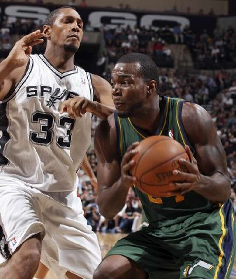 The Spurs'  Boris Diaw defends the Jazz's Paul Millsap during first half action of Game 2 of the Western Conference first round Wednesday May 2, 2012 at the AT&T Center.  EDWARD A. ORNELAS/SAN ANTONIO EXPRESS-NEWS (EDWARD A. ORNELAS / SAN ANTONIO EXPRESS-NEWS)