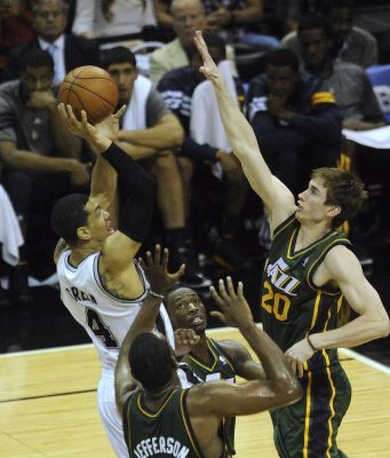 The Spurs' Danny Green (4) shoots over the Jazz's Al Jefferson (25), Josh Howard, middle, and Gordon Hayward (20) during NBA playoffs action at the AT&T Center on Wednesday, May 2, 2012.  Billy Calzada / San Antonio Express-News (BILLY CALZADA / San Antonio Express-News)