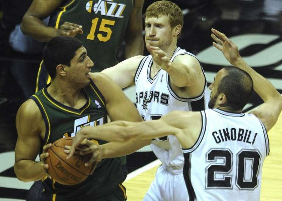 Manu Ginobili (20) of the Spurs steals the ball from Enes Kanter of the Jazz as Matt Bonner of the Spurs defends during NBA playoffs action at the AT&T Center on Wednesday, May 2, 2012.  Billy Calzada / San Antonio Express-News (BILLY CALZADA / San Antonio Express-News)