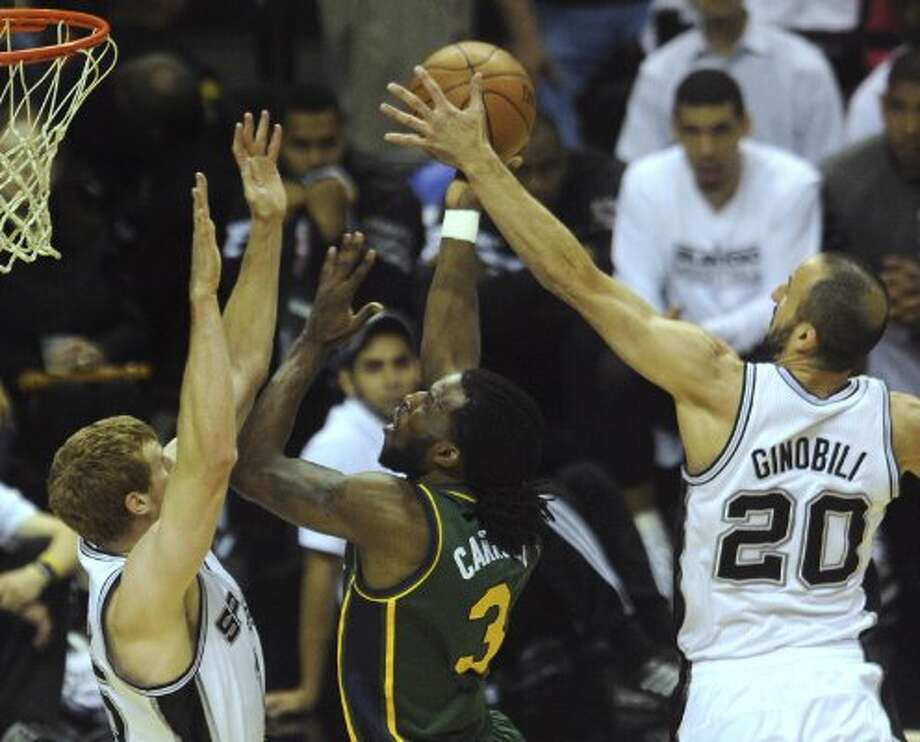 Manu Ginobili of the Spurs blocks a shot attempt by DeMarre Carroll of the Jazz as Matt Bonner of the Spurs defends during NBA playoffs action at the AT&T Center on Wednesday, May 2, 2012.  Billy Calzada / San Antonio Express-News (BILLY CALZADA / San Antonio Express-News)