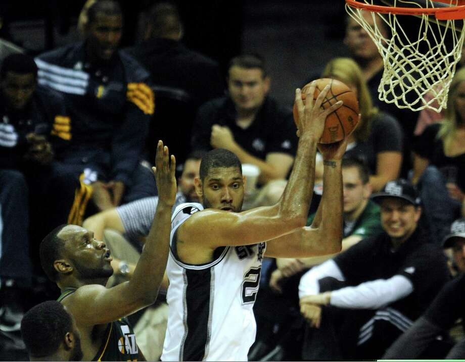 Tin Duncan of the Spurs hauls in a rebound during second-half NBA playoffs action against the Jazz at the AT&T Center on Wednesday, May 2, 2012.  Billy Calzada / San Antonio Express-News Photo: BILLY CALZADA, San Antonio Express-News / SAN ANTONIO EXPRESS-NEWS