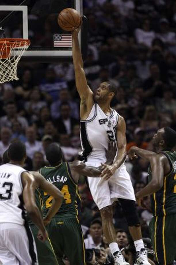 The Spurs'  Tim Duncan goes for a dunk through the Jazz's Paul Millsap during the second half of game two of the Western Conference first round at the AT&T Center, Sunday, May 2, 2012. The Spurs won 114-83 and lead the series, 2-0. Jerry Lara/San Antonio Express-News (Jerry Lara / San Antonio Express-News)