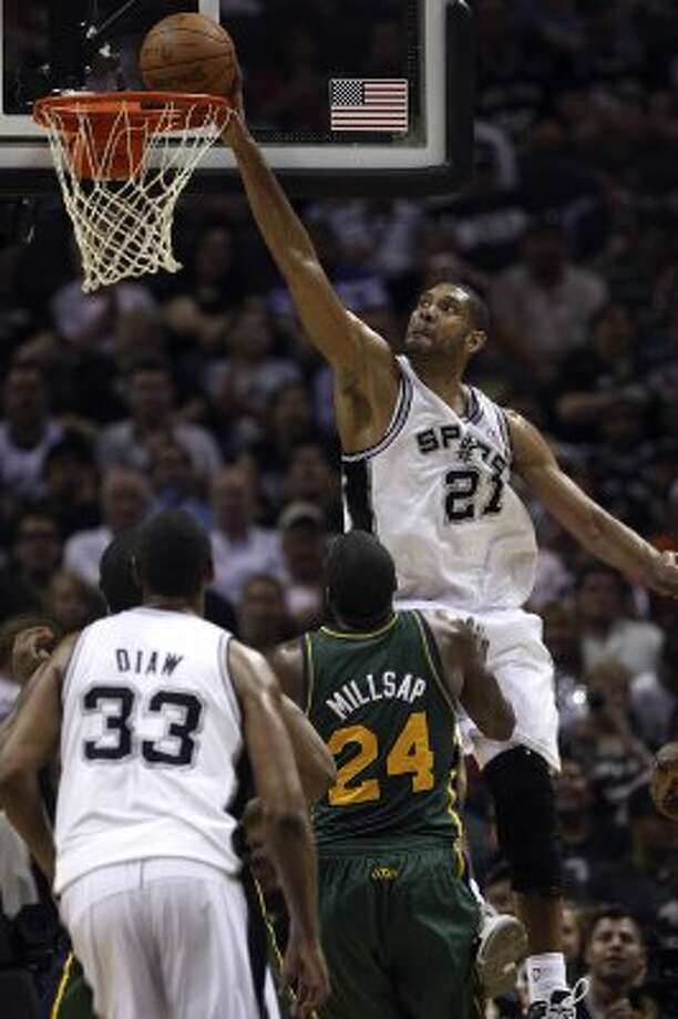 The Spurs'  Tim Duncan dunks the ball against the Jazz during the second half of game two of the Western Conference first round at the AT&T Center, Sunday, May 2, 2012. The Spurs won 114-83 and lead the series, 2-0. Jerry Lara/San Antonio Express-News (Jerry Lara / San Antonio Express-News)
