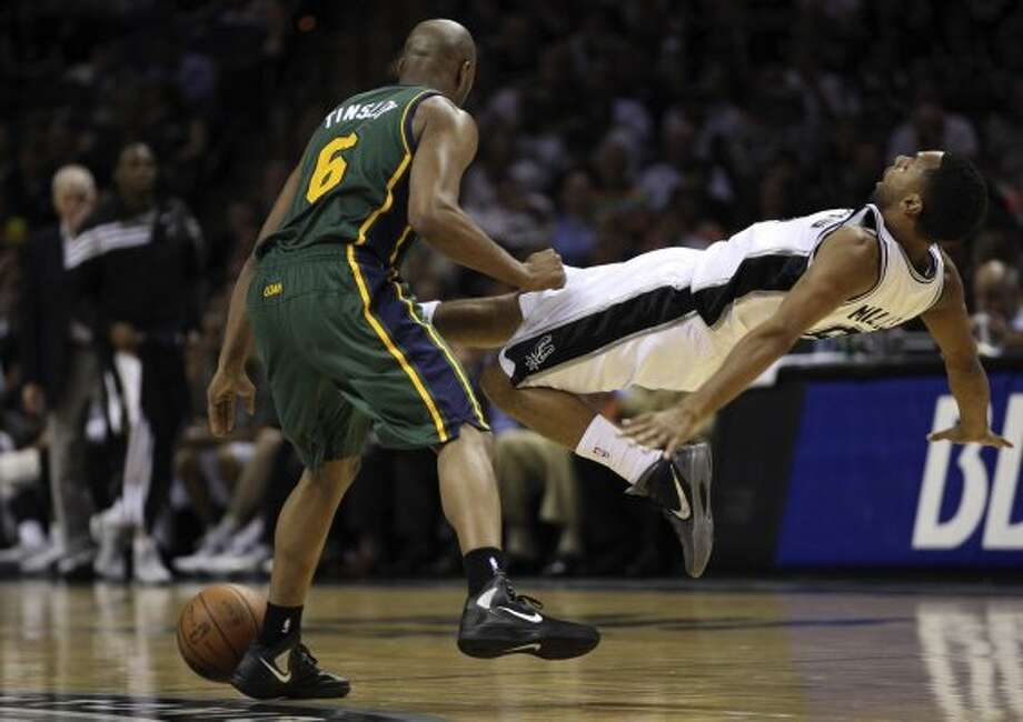 The Spurs'  Patty Mills gets fouled by the Jazz's Jamaal Tinsley during the second half of game two of the Western Conference first round at the AT&T Center, Sunday, May 2, 2012. The Spurs won 114-83 and lead the series, 2-0. Jerry Lara/San Antonio Express-News (Jerry Lara / San Antonio Express-News)