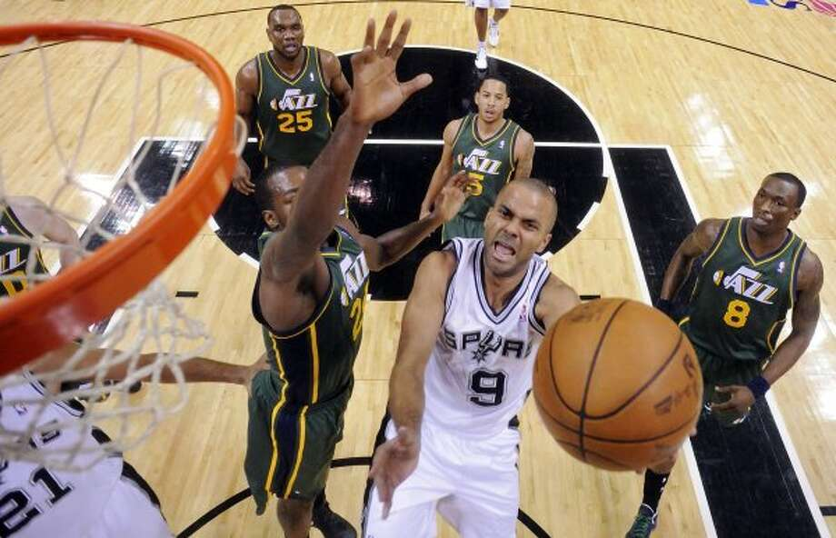 The Spurs'  Tony Parker shoots around the Jazz's Paul Millsap during first half action of Game 2 of the Western Conference first round Wednesday May 2, 2012 at the AT&T Center. The Spurs won 114-83.  EDWARD A. ORNELAS/SAN ANTONIO EXPRESS-NEWS (EDWARD A. ORNELAS / SAN ANTONIO EXPRESS-NEWS)