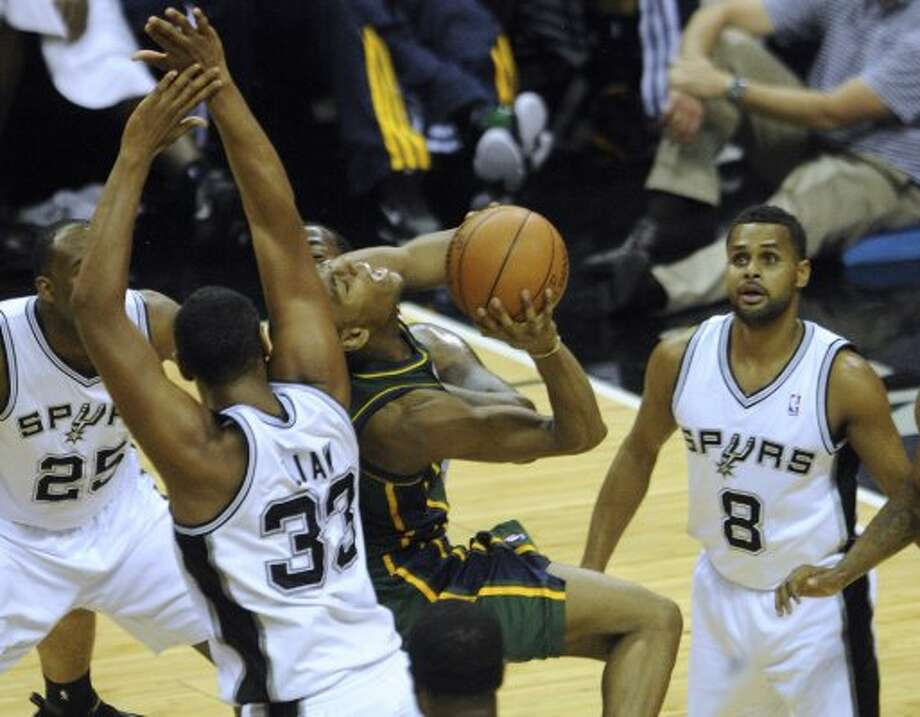 Alec Burks (10) of the Jazz shoots a layup as he is defended by Boris Diaw (33), James Anderson (25), Patty Mills (8) and Stephen Jackson (3) of the Spurs during second-half NBA playoffs action at the AT&T Center on Wednesday, May 2, 2012.  Billy Calzada / San Antonio Express-News (BILLY CALZADA / San Antonio Express-News)