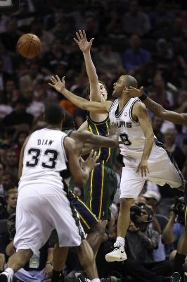 The Spurs'  Tony Parker shoots the ball as the Jazz's Gordon Hayward tries to defend during the second half of game two of the Western Conference first round at the AT&T Center, Sunday, May 2, 2012. The Spurs won 114-83 and lead the series, 2-0. Jerry Lara/San Antonio Express-News (Jerry Lara / San Antonio Express-News)