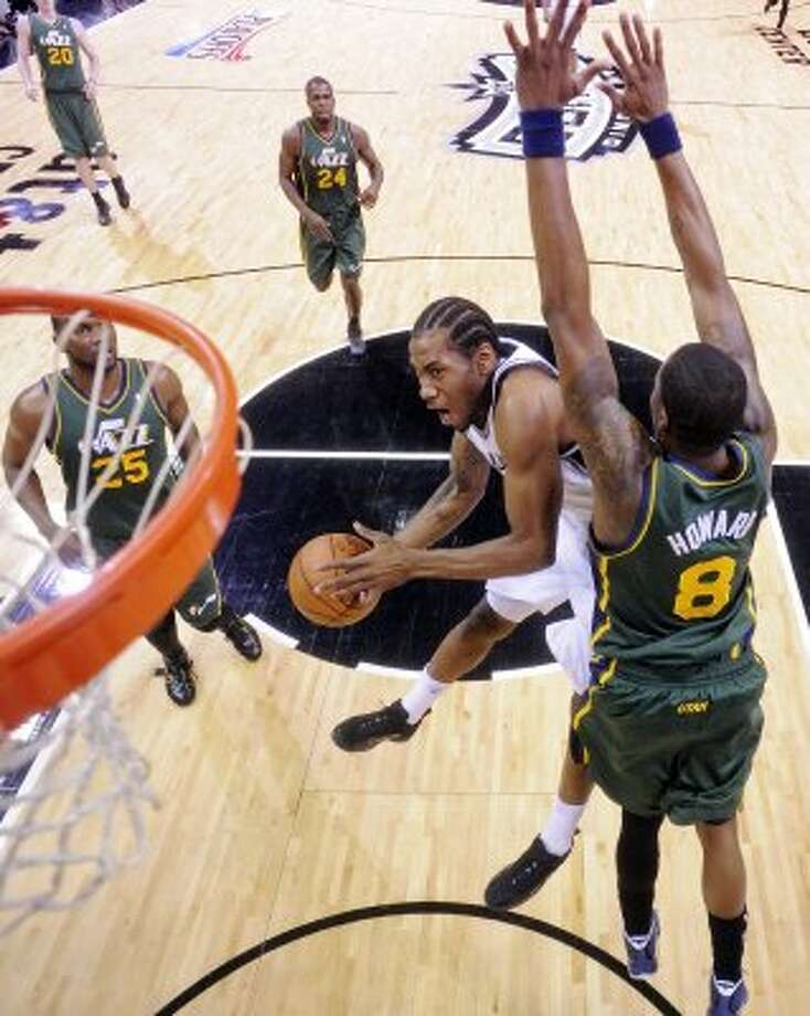 The Spurs'  Kawhi Leonard drives to the basket around Utah Jazz Josh Howard during first half action of Game 2 of the Western Conference first round Wednesday May 2, 2012 at the AT&T Center. The Spurs won 114-83.  EDWARD A. ORNELAS/SAN ANTONIO EXPRESS-NEWS (EDWARD A. ORNELAS / SAN ANTONIO EXPRESS-NEWS)