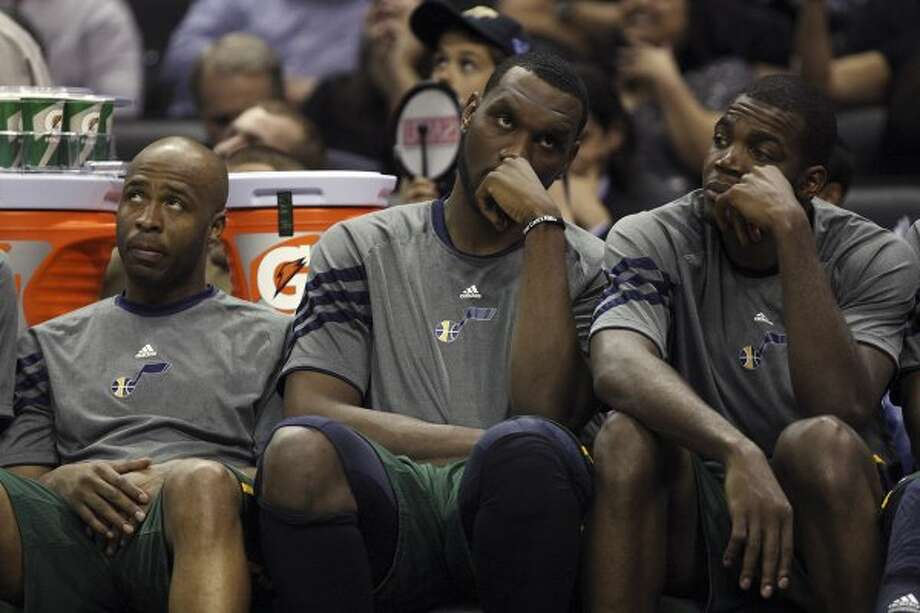 Utah's Jamaal Tinsley (left), Al Jefferson and Paul Millsap watch Game 2 well after the outcome was decided.