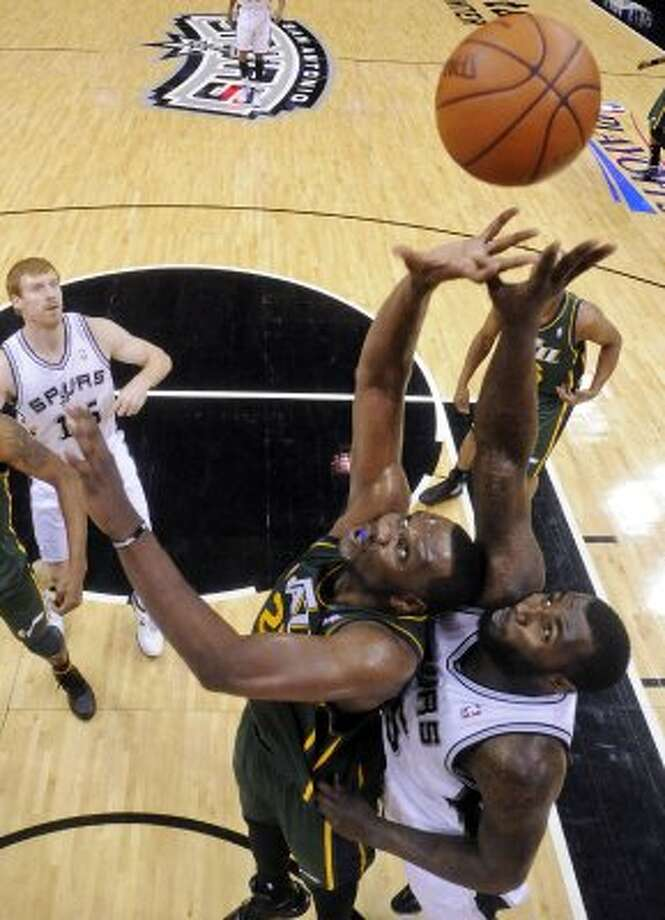 FOR SPORTS - Utah Jazz Al Jefferson and San Antonio Spurs DeJuan Blair grab for a rebound during first half action of Game 2 of the Western Conference first round Wednesday May 2, 2012 at the AT&T Center. The Spurs won 114-83.  (PHOTO BY EDWARD A. ORNELAS/SAN ANTONIO EXPRESS-NEWS) (EDWARD A. ORNELAS / SAN ANTONIO EXPRESS-NEWS)