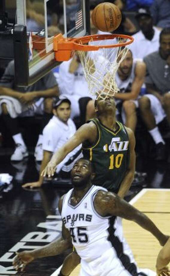 DeJuan Blair of the Spurs (25) and Alec Burks (10) of the Utah Jazz watch the ball as it drops in for two points for Blair during second-half NBA playoffs action at the AT&T Center on Wednesday, May 2, 2012.  Billy Calzada / San Antonio Express-News (BILLY CALZADA / San Antonio Express-News)