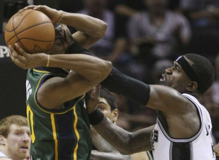 The Spurs' Stephen Jackson covers the Jazz's Alec Burks during the first half of game two of the Western Conference first round at the AT&T Center, Sunday, May 2, 2012. Jerry Lara/San Antonio Express-News (Jerry Lara / San Antonio Express-News)