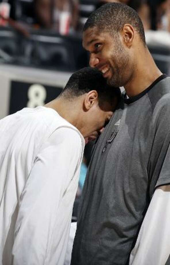The Spurs'  Danny Green and tTim Duncan joke during a timeout during second half action of Game 2 of the Western Conference first round against the Utah Jazz Wednesday May 2, 2012 at the AT&T Center. The Spurs won 114-83.  EDWARD A. ORNELAS/SAN ANTONIO EXPRESS-NEWS (EDWARD A. ORNELAS / SAN ANTONIO EXPRESS-NEWS)