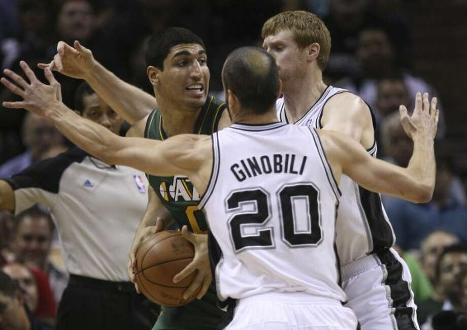 The Spurs'  Manu Ginboli and Matt Bonner surround  Utah Jazz Enes Kanter during the first half of game two of the Western Conference first round at the AT&T Center, Sunday, May 2, 2012. Jerry Lara/San Antonio Express-News (Jerry Lara / San Antonio Express-News)